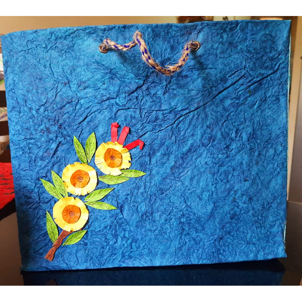 BLUE WITH FLOWERS PAPER BAG