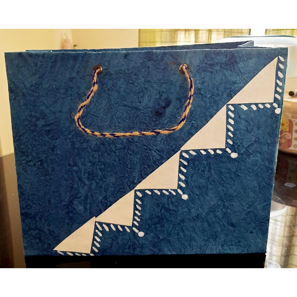 BLUE WITH TRIANGULAR DESIGN PAPER BAG